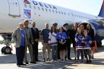 Delta crew and some select passengers to pose with Rangers legends Rod Gilbert and Ron Duguay. (Photo by Matt Molnar/NYCAviation)