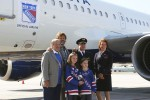 Rod Gilbert, Ron Duguay pose with the flight's captain and head flight attendant. (Photo by Matt Molnar/NYCAviation)