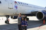 Rod Gilbert, Ron Duguay pose in front of the plane with the captain and some young fans. (Photo by Matt Molnar/NYCAviation)