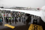 Crowds take refuge from the rain under the wing. (Photo by Jeremy Dwyer-Lindgren)