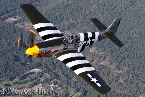 HFF founder & owner John Sessions flies HFF's P-51 Impatient Virgin over the foothills of the Cascades.