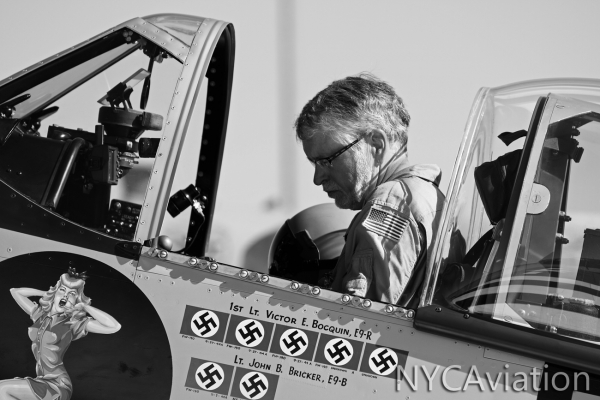 Sessions checks over a few checklists during a morning run up of the P-51.