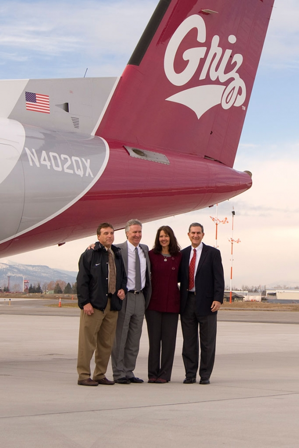University of Montana and Horizon Air execs take a photo op under the tail