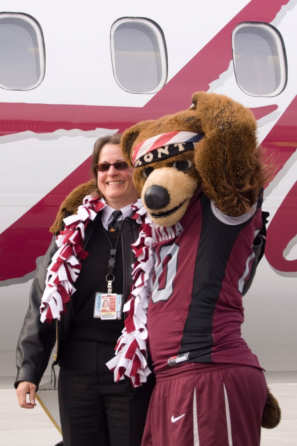 Monte the bear poses with Captain Susan Roy