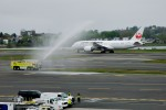 JAL's first Boeing 787-8 Dreamliner (JA822J) receives a water cannon salute from a Boston Logan fire truck.  (Photo by Bill Vogt/NYCAviation)