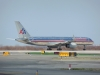 American Air lines up and waits on runway 31L