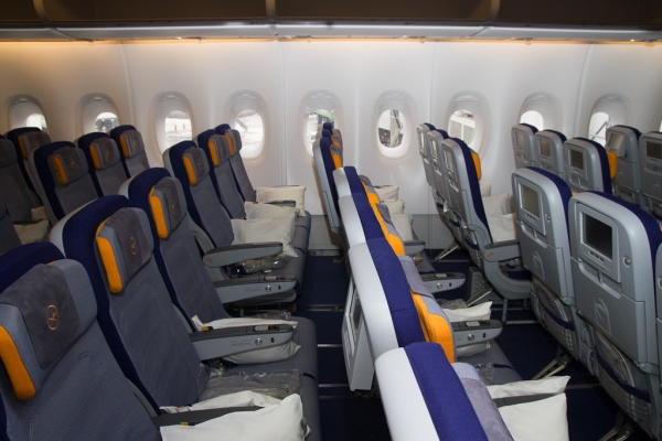 New slimline economy class seats provide 2in additional personal space. (Photo by Eric Dunetz/NYCAviation)