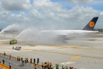 At 1:40pm, the German giant settled on the runway and taxied through a welcoming water cannon salute provided by four Miami-Dade Fire Department fire tenders to the terminal. (Photo by Mark Lawrence)
