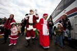 Santa leads a following of admirers from his plane to the museum. (Photo by Jeremy Dwyer-Lindgren)