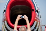 A visitor snaps a picture into the intake of the venerable F-86 intake.