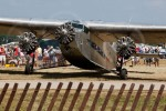 A Ford Tri-Motor stops briefly to pick up passengers on another revenue flight.