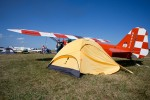 A stunning 1958 bult Piper J3C-65 Cub rests behinds its owners tent. AirVenture 2012 was dedicated to the venerable Cubs 75th Anniversary.