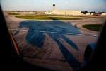 Our plane casts a warped shadow just before touching down at KMDW.