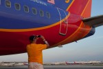 An employee takes one last shot before this year's Southwest Airventure Adventure draws to a close on a Saturday evening.
