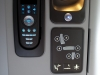 Here you can see the remote (again) along with other seat controls, reading light, and power/USB outlets.