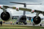 Airbus A400M Atlas is seen past the wing of an A380 on static display. (Photo by Airbus)