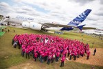 An Airbus flash mob greets an A380. (Photo by Farnborough International)