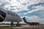 Two of the world's latest widebody aircraft together at Farnborough Airport: Airbus Military's A400M military airlifter joins the A380 of Malaysia Airlines in the air show's static display area. (Photo by Airbus)