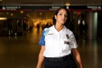 "Terminal security agent Ericka Middleton (""The Charmer"") poses in the main concourse. (Photo by Travel Channel)"