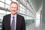 "Deputy director of operations Ken Pyatt (""The Boss"") poses by the moving walkway. (Photo by Travel Channel)"