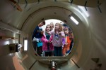 Former NASA shuttle astronauts Wendy Lawrence (L) and Nicholas Patrick (R) show Julianna (8) & Emily Heiland (11) the airlock of the shuttle trainer. (Photo by Jeremy Dwyer-Lindgren/NYCAviation)