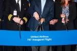 United CEO Jeff Smisek cuts the ribbon ahead of the first 787 flight. (Photo by Kevin Koske)