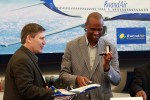 Rob Faye, Director of Boeing Commercial Airplanes, hands over the keys to RwandAir CEO John Mirenge.