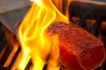 A salmon filet cooks on the grill. (Photo by Jeremy Dwyer-Lindgren/NYCAviation)