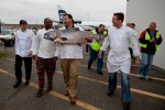 From left to right: Executive chef Pat Donahue, of Anthony's Restaurants; executive chef Wayne Johnson of Ray's Boathouse, Frankie Ragusa of Ocean Beauty Seafoods, and executive chef Jason Wilson of Crush, walk with a 55 pound Copper River King Salmon after the first delivery. (Photo by Jeremy Dwyer-Lindgren/NYCAviation)
