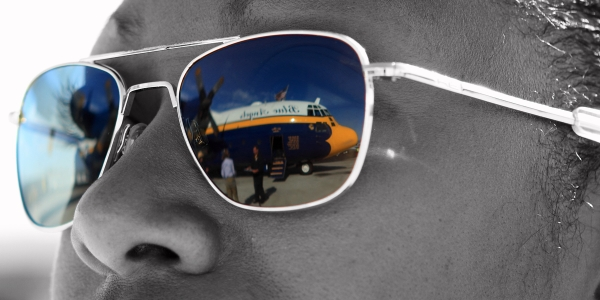 A Navy Airman gazes at our ride, the C-130 they call Fat Albert.