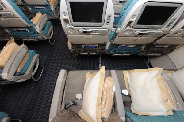 Economy seat pillow blanket entertainment system legroom.  (Photo by Manny Gonzalez)