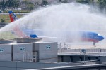 Southwest's first Boeing 737-800 revenue flight (Warrior One, N8301J) receives a water cannon salute upon arrival in Fort Lauderdale. (Photo by Mark Lawrence/NYCAviation)
