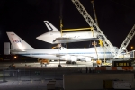 Space Shuttle Enterprise is lifted off of the Shuttle Carrier Aircraft using two cranes. (Photo by Eric Dunetz)