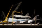 A set of cranes and wind restraints constructed to remove space shuttle Enterprise from atop NASA's 747 Shuttle Carrier Aircraft are being put into place. (Photo by NASA/Kim Shiflet)