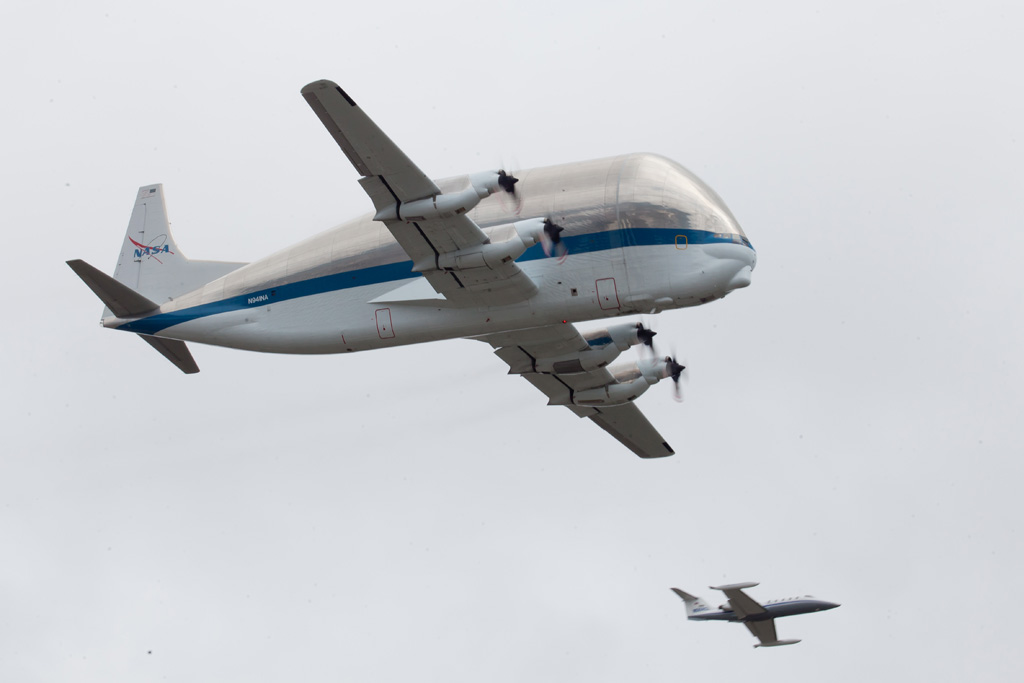 When it arrived in the Seattle area, the Super Guppy performed a pass over the Boeing Field runway escorted by Clay Lacy in his Learjet 35. (Photo by Liem Bahneman/NYCAviation)