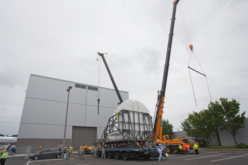At the back of the gallery, cranes would lift the cockpit sections by its own hard points from the steel chassis and in to the Museum of Flight's own steel cradle that would carry it through the back door of the building, which was too small to be performed while in the transport cradle and tunner. (Photo by Liem Bahneman/NYCAviation)