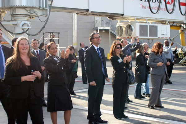 Airline and airport employees applaud the arrival. (Photo by Stephen Shrank/NYCAviation)