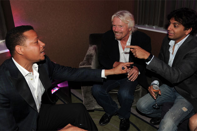 In this photo released by Virgin America Airlines, Terrence Howard, M. Night Shyamalan and Sir Richard Branson share a laugh at Hotel Palomar. (Bloomberg Photo/Virgin America Airlines, Bob Riha, Jr.)
