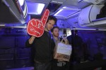 Glenn Howerton and Seth Green pose with the foam finger.  (Photo by Manny Gonzalez/NYCAviation)