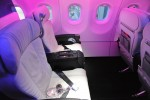 Virgin America First Class seats under the purple mood lighting. (Photo by Manny Gonzalez/NYCAviation)