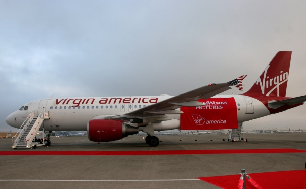 Virgin America's Airbus A320 <em>Real Steel</em> waits to have its new art revealed outside of the Flight Path Learning Center Museum at Los Angeles International Airport. (Photo by Stephen Shrank)