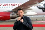 Jackman poses with fists raised in front of <em>Real Steel</em>; Virgin America's new Airbus A320 featuring artwork of Atom the World Robot Boxing contender from the new Dreamworks Pictures film <em>Real Steel</em>. (Photo by Stephen Shrank)