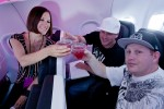 Contest winners toast during the flight. (Photo by Jeremy Dwyer-Lindgren/NYCAviation)