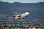 One of Virgin's A319s, N524VA, lifts off from LAS as flight 770 to SFO. (Photo by gTarded)