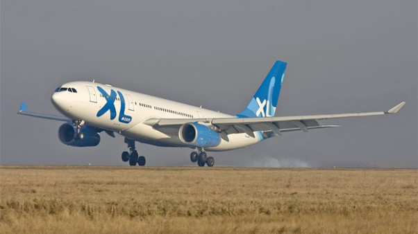 XL Airways France A330-243 (F-GRSQ) seconds from touching down at CDG.