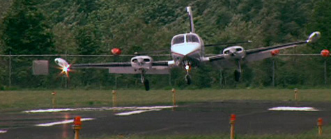 A plane lands on the resurfaced runway at Wiliamson-Sodus Airport near Lake Ontario in upstate New York. The airport is owned by the private Williamson Flying Club. Photo by CBS News