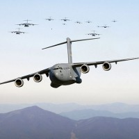 C-17 Globemaster IIIs on a low-level training mission [by Staff Sgt. Jacob N. Bailey, U.S. Air Force]