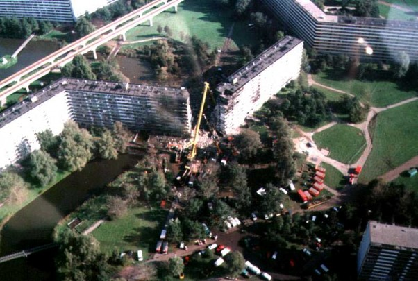 A 747 freighter being flown by El Al crashed into this apartment complex in Amsterdam, killing 39 on the ground in addition to the 4 on-board.