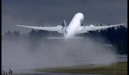 A Cathay Pacific Boeing 777-300ER takes off from Washington on a delivery flight. (Photo by Jeremy Dwyer-Lindgren)