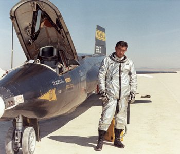 Pilot Michael J. Adams alongside the X-15.
